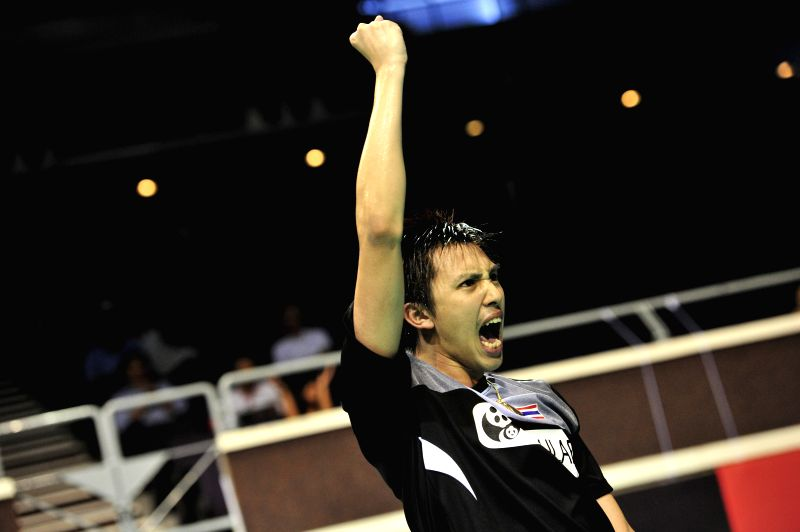Tanongsak Saensomboonsuk of Thailand celebrates after winning his men's singles round two match of OUE Singapore Open against K. Srikanth of India in Singapore, ...