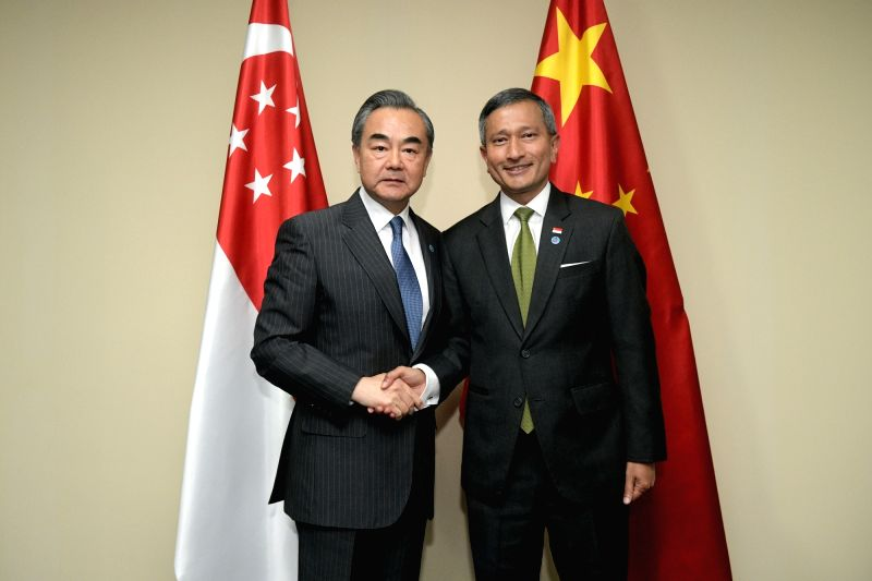 SINGAPORE, Aug. 1, 2018 - Visiting Chinese State Councilor and Foreign Minister Wang Yi (L) meets with his Singaporean counterpart Vivian Balakrishnan in Singapore, Aug. 1, 2018. - Wang Y
