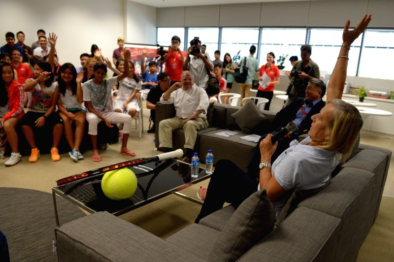 Former United States' tennis player Martina Navratilova (R) speaks to junior athletes at Singapore Sports Institute on Aug. 14, 2014. Martina Navratilova attends .