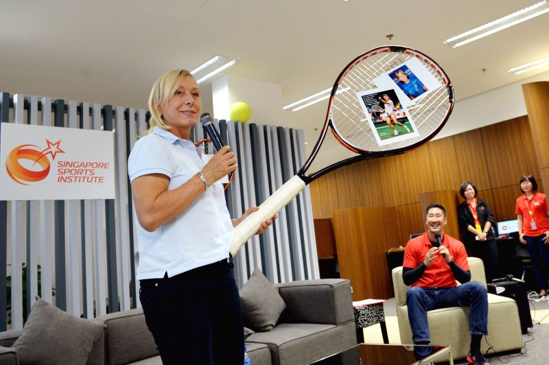 Former United States' tennis player Martina Navratilova (L) speaks to junior athletes at Singapore Sports Institute on Aug. 14, 2014. Martina Navratilova attends .
