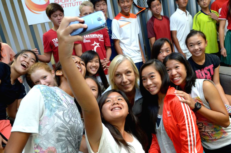 Former United States' tennis player Martina Navratilova (C) poses with junior athletes at Singapore Sports Institute on Aug. 14, 2014. Martina Navratilova attends