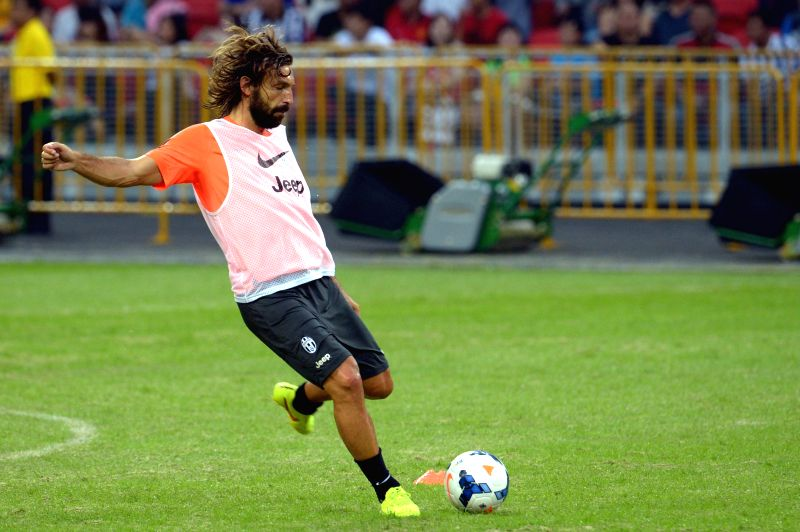 Italy's Juventus Football Club's player Andrea Pirlo attends a pre-match training session at the Singapore National Stadium on Aug. 15, 2014. Juventus Football ...