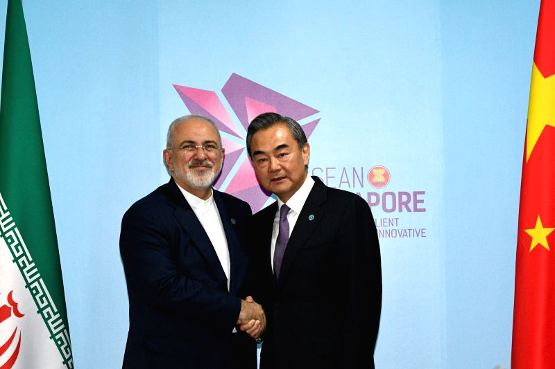 SINGAPORE, Aug. 3, 2018 - Chinese State Councilor and Foreign Minister Wang Yi (R) meets with Iranian Foreign Minister Mohammad Javad Zarif in Singapore, Aug. 3, 2018. - Wang Y