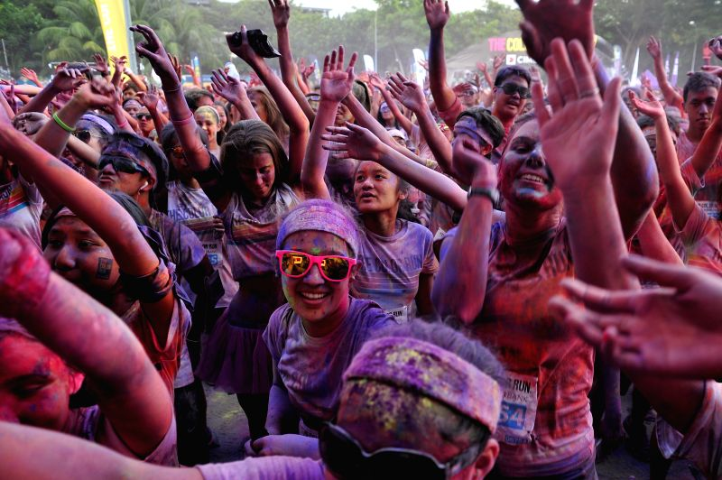 People participate in the Color Run on Singapore's Sentosa Island on Aug. 30, 2014. The two-day Color Run kicked off on Singapore's Sentosa Island on Saturday. ...