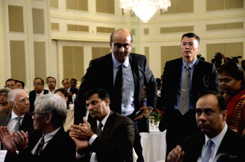 Singapore Deputy Prime Minister Tharman Shanmugaratnam and Reserve Bank of India (RBI) Governor Raghuram Rajan during CII's Singapore Symposium 2016 in Mumbai on April 7, 2016. - Tharman Shanmugaratna