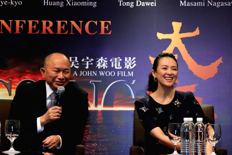 """Director John Woo and actress Zhang Ziyi attend a press conference for the movie """"The Crossing I"""" in Singapore, on Dec. 4, 2014. - Zhang Ziyi"""