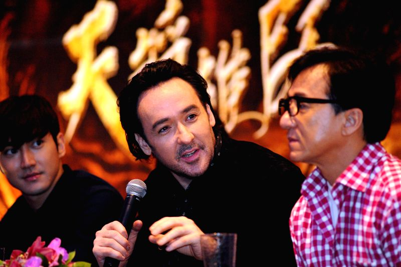 """Actors Jackie Chan (R), John Cusack (C) and Choi Si-won attend the press conference of movie """"Dragon Blade"""" in Singapore, Feb. 10, 2015. Cast members of - Jackie Chan"""