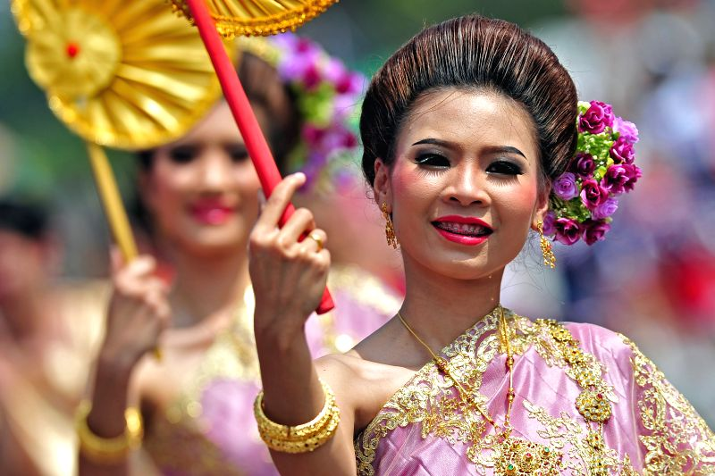 Thai performers attend a preview of the 2015 Chingay Parade at Singapore's F1 Pit Building Feb. 26, 2015. International contingents participated in a media ...