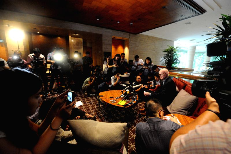 Former U.S. special representative for DPRK policy Stephen Bosworth (R) attends the press conference in Sheraton Towers Singapore on Jan. 19, 2015. The chief ...