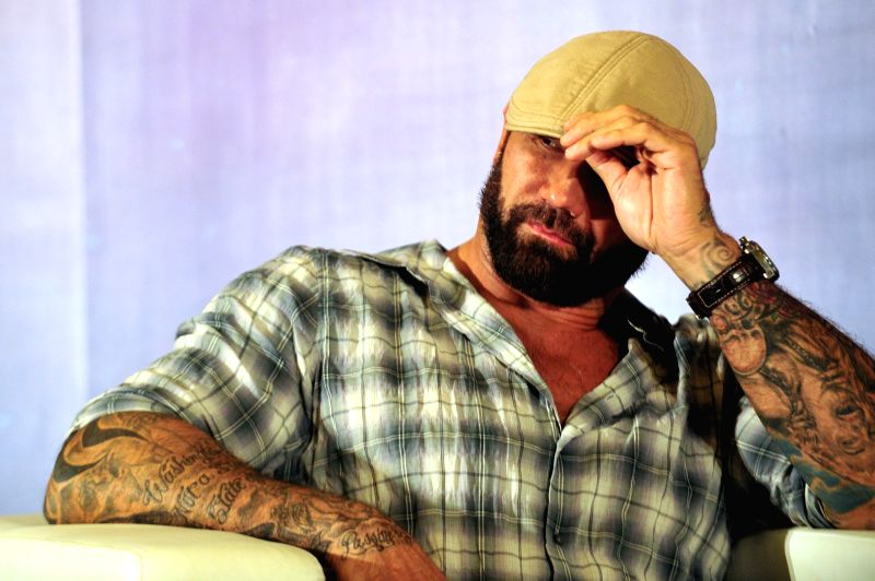 Actor Dave Batista attends a press conference held in Singapore's Marina Bay Sands Expo, July 10, 2014. Director and some of the main cast of movie ... - Dave Batista
