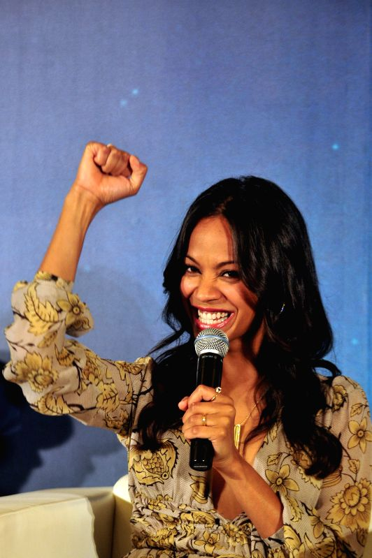 "Actress Zoe Saldana gestures during a press conference of the American movie ""Guardians of the Galaxy"" held in Singapore's Marina Bay Sands Expo on July - Zoe Saldana"