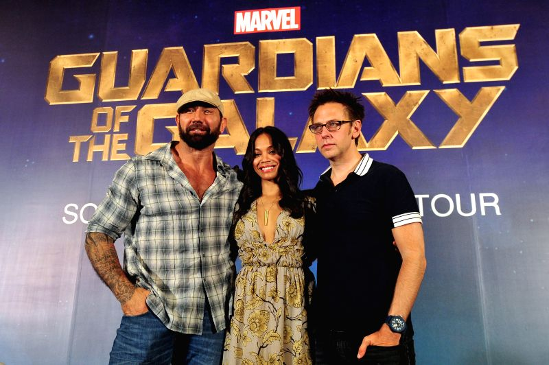 "Director James Gunn (R) , actor Dave Batista (L) and actress Zoe Saldana attend a press conference of the American movie ""Guardians of the Galaxy"" held . - Dave Batista"