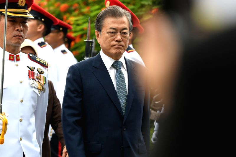 SINGAPORE, July 12, 2018 - Visiting South Korean President Moon Jae-in (C) attends the welcome ceremony held in Singapore's Istana, on July 12, 2018. Moon Jae-in's state visit to Singapore will last ...
