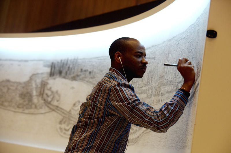 Britain's autistic artist Stephen Wiltshire gives the final touch to the panorama of Singapore in Singapore's Paragon Shopping Centre on July 20, 2014. Stephen ... - Stephen Wiltshire