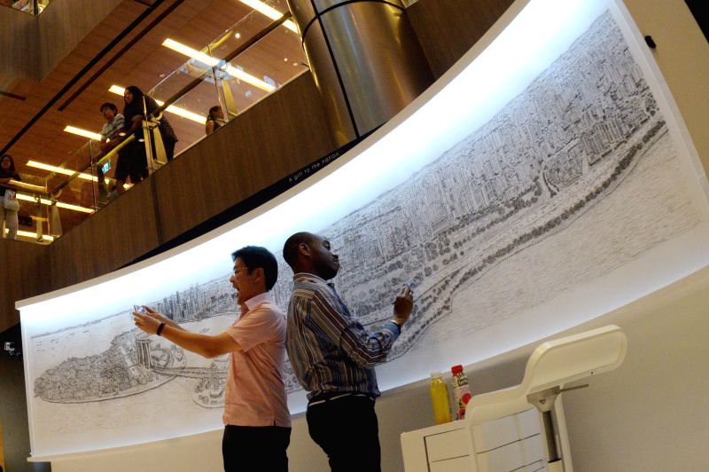 Singapore's Minister for Culture, Community and Youth & 2nd Minister for Ministry of Communications and Information Lawrence Wong (L) takes a selfie while ... - Stephen Wiltshire
