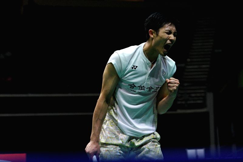 SINGAPORE, July 21, 2018 - Chou Tien Chen of Chinese Taipei celebrates during the men's singles semi-final match against Qiao Bin of China at 2018 Singapore Badminton Open held at Singapore Indoor ...