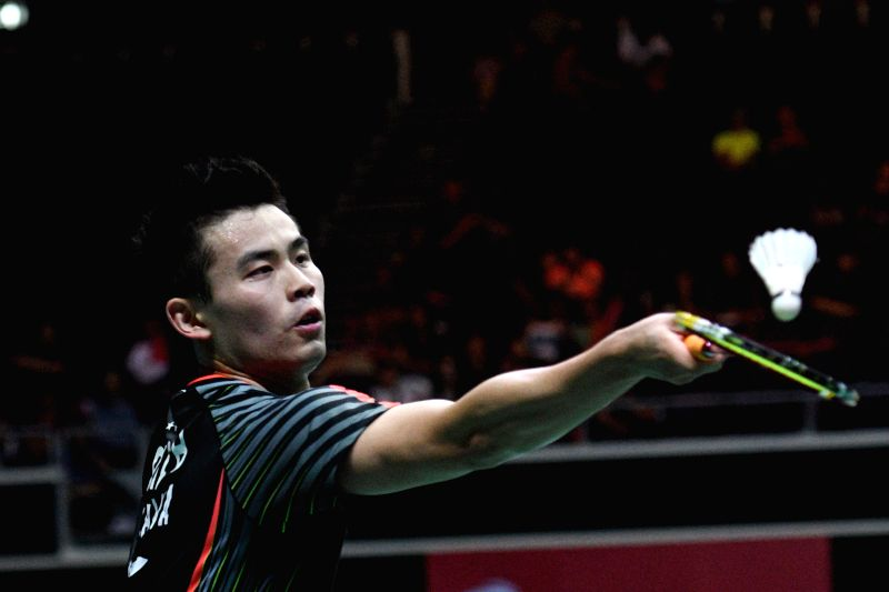 SINGAPORE, July 21, 2018 - Qiao Bin of China hits a return during the men's singles semi-final match against Chou Tien Chen of Chinese Taipei at 2018 Singapore Badminton Open held at Singapore Indoor ...