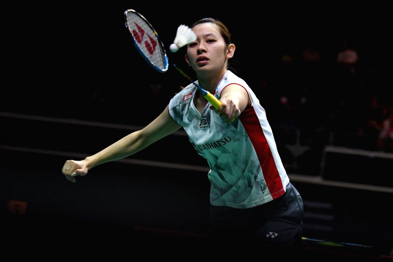 SINGAPORE, July 21, 2018 - Sayaka Takahashi of Japan hits a return during the women's singles semi-final match against Han Yue of China at 2018 Singapore Badminton Open held at Singapore Indoor ...