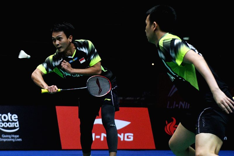 SINGAPORE, July 22, 2018 - Indonesia's Mohammad Ahsan (L) /Hendra Setiawan compete during the men's doubles final against Ou Xuanyi/Ren Xiangyu of China at the Singapore Badminton Open held at the ...