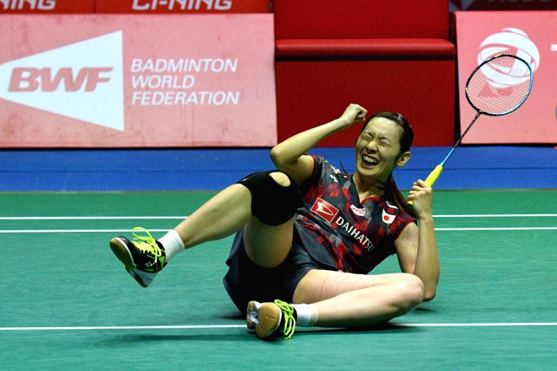 SINGAPORE , July 22, 2018 - Japan's Sayaka Takahashi reacts after winning the women's final match against China's Gao Fangjie at the Singapore Badminton Open in Singapore, July 22, 2018. Sayaka ...