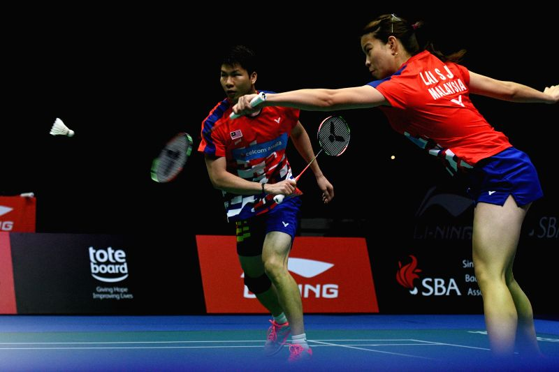 SINGAPORE, July 22, 2018 - Malaysia's Goh Soon Huat/Shevon Jemie Lai (R) compete during the mixed double's final against Tontowi Ahmad /Liliyana Natsir of Indonesia at the Singapore Badminton Open ...
