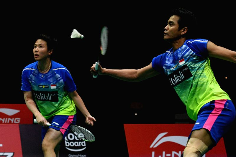 SINGAPORE, July 22, 2018 - Tontowi Ahmad (R)/Liliyana Natsir of Indonesia compete during the mixed double's final against Malaysia's Goh Soon Huat/Shevon Jemie Lai at the Singapore Badminton Open ...