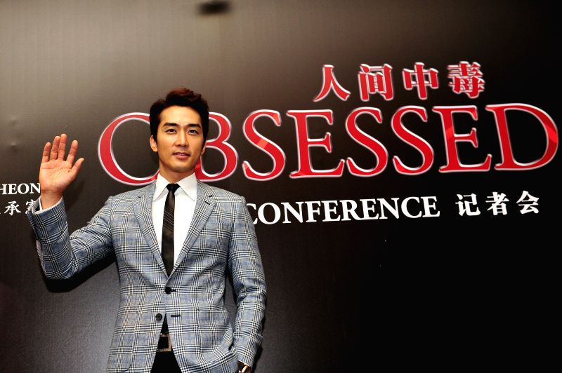 "South Korean actor Song Seung-heon attends the press conference of the film ""Obsessed"" in Singapore, July 25, 2014.  ... - Song Seung"