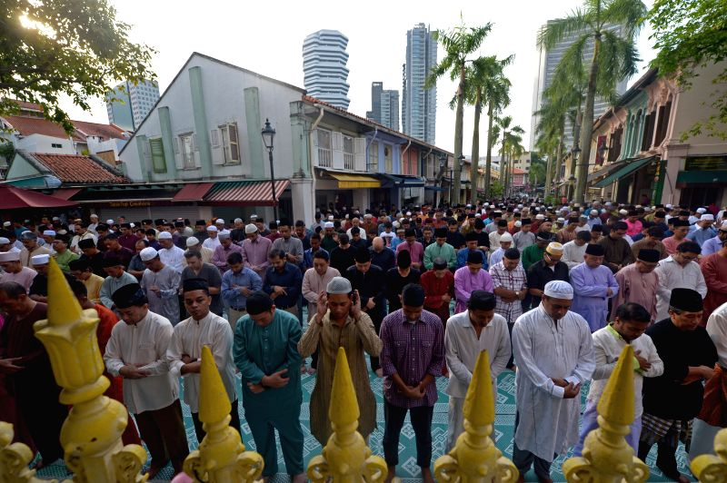 Muslims attend morning prayers held at Sultan Mosque in Singapore on July 28, 2014. Muslims in Singapore on Monday celebrated Eid al-Fitr, marking the end of ...