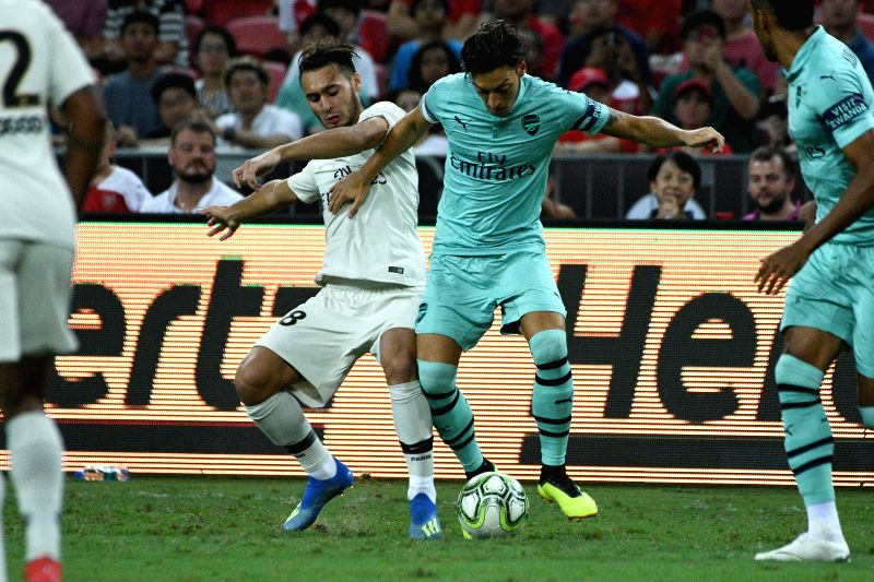SINGAPORE, July 28, 2018 - Arsenal's Mesut Ozil (2nd R) vies with Paris Saint-Germain's Azzedine Toufiqui (2nd L) during the International Champions Cup soccer match held in Singapore on July 28, ...