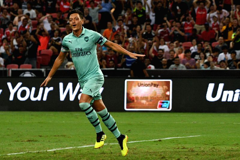 SINGAPORE, July 28, 2018 - Arsenal's Mesut Ozil celebrates after scoring during the International Champions Cup soccer match between Arsenal and Paris Saint-Germain held in Singapore on July 28, 2018.