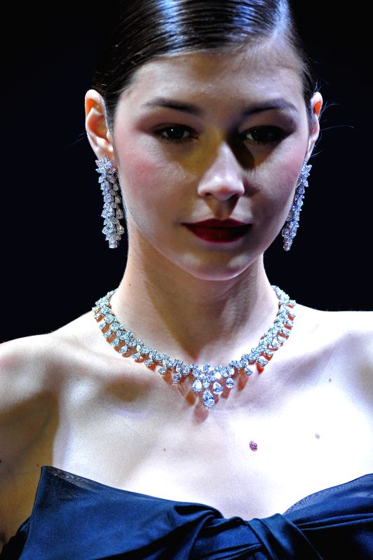 A model presents jewelry creations at a fashion show during the Singapore International Jewelry Expo held in Singapore's Marina Bay Sands Expo, on July 3, 2014. ...