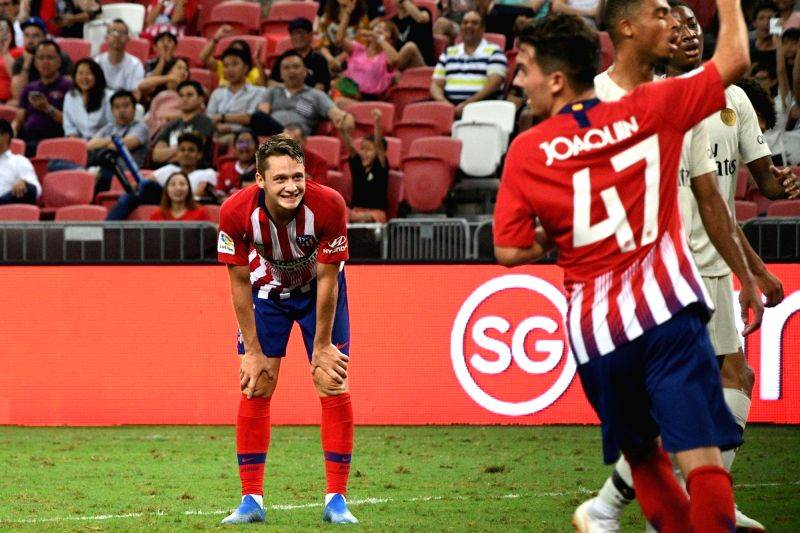SINGAPORE, July 30, 2018 - Atletico de Madrid's Borja Garces (L) reacts after scoring a goal during the International Champions Cup match between Paris Saint-Germain and Atletico de Madrid held in ...