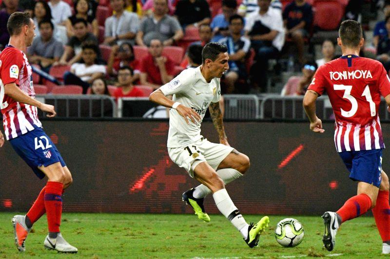 SINGAPORE, July 30, 2018 - Paris Saint-Germain's Angel Di Maria (C) drives the ball during the International Champions Cup match between Paris Saint-Germain and Atletico de Madrid held in Singapore ...