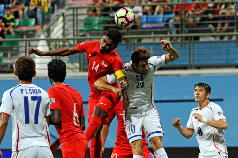 SINGAPORE, June 10, 2017 - Singapore's player Hariss Harun (3rd L) vies with Chinese Taipei's player Chu En-Le (2nd R) during the Asian Football Confederation Asian Cup Group E qualifier match ...