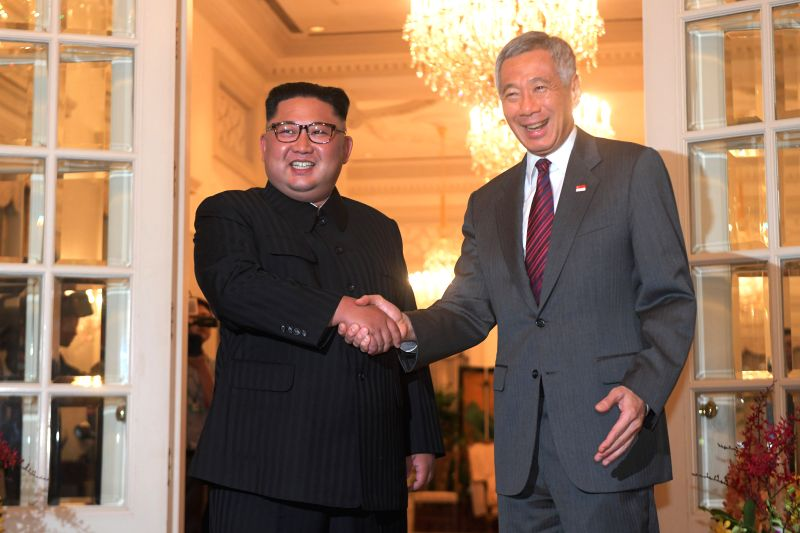 SINGAPORE, June 10, 2018 - Singaporean Prime Minister Lee Hsien Loong (R) shakes hands with Kim Jong Un, chairman of the Workers' Party of Korea (WPK) and chairman of the State Affairs Commission of ... - Lee Hsien Loong