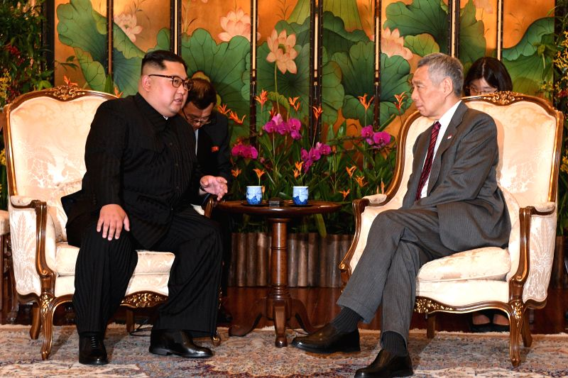 SINGAPORE, June 10, 2018 - Singaporean Prime Minister Lee Hsien Loong (R) meets with Kim Jong Un, chairman of the Workers' Party of Korea (WPK) and chairman of the State Affairs Commission of the ... - Lee Hsien Loong