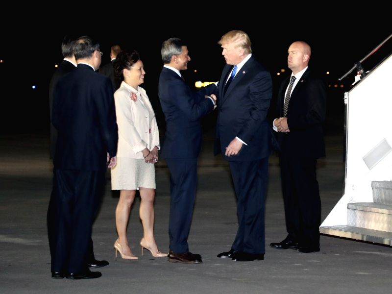 SINGAPORE, June 10, 2018 - U.S. President Donald Trump (2nd R) arrives in Singapore on June 10, 2018.
