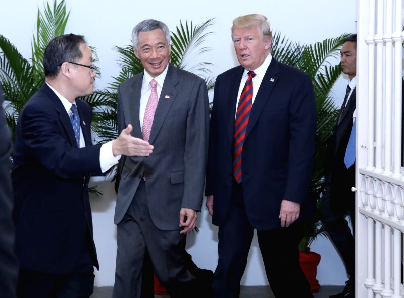 SINGAPORE, June 11, 2018 - Singapore's Prime Minister Lee Hsien Loong (2nd L) meets with U.S. President Donald Trump (3rd L) in Singapore, on June 11, 2018. - Lee Hsien Loong