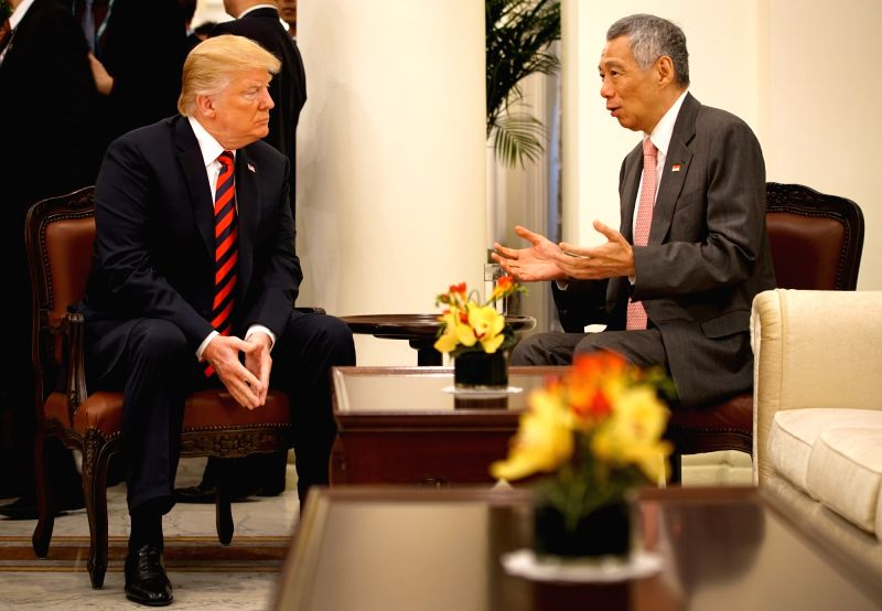 SINGAPORE, June 11, 2018 - Singapore's Prime Minister Lee Hsien Loong (R) meets with U.S. President Donald Trump in Singapore, on June 11, 2018. - Lee Hsien Loong