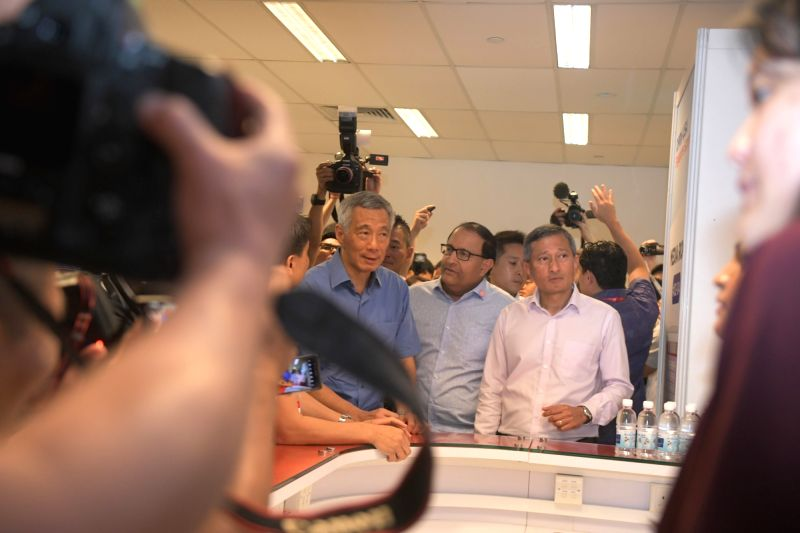 SINGAPORE, June 11, 2018 - Singapore's Prime Minister Lee Hsien Loong (1st L) visits the international media center in Singapore, June 10, 2018. The much-anticipated meeting between U.S. President ... - Lee Hsien Loong
