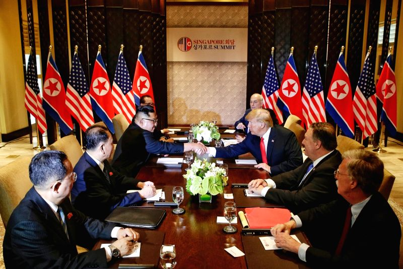SINGAPORE, June 12, 2018 - Top leader of the Democratic People's Republic of Korea (DPRK) Kim Jong Un (3rd L) holds talks with U.S. President Donald Trump (3rd R) in Singapore, on June 12, 2018.