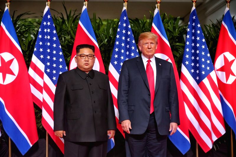 SINGAPORE, June 12, 2018 - Top leader of the Democratic People's Republic of Korea (DPRK) Kim Jong Un (L) meets with U.S. President Donald Trump in Singapore, on June 12, 2018.