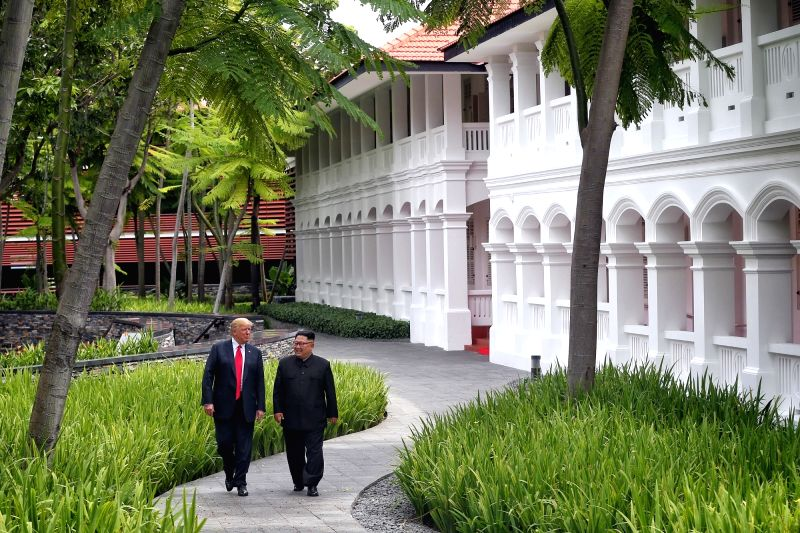 SINGAPORE, June 12, 2018 - Top leader of the Democratic People's Republic of Korea (DPRK) Kim Jong Un (R) and U.S. President Donald Trump take a walk during their summit meeting in Singapore on June ...