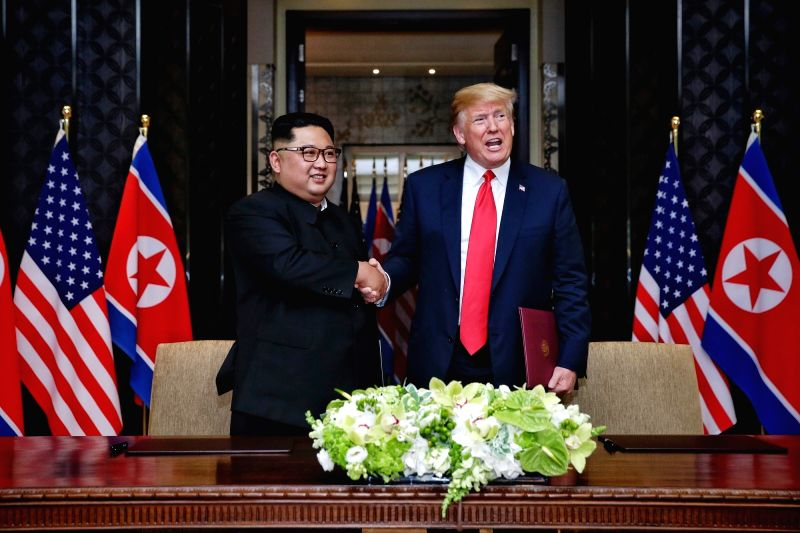 SINGAPORE, June 12, 2018 - Top leader of the Democratic People's Republic of Korea (DPRK) Kim Jong Un (L) shakes hands with U.S. President Donald Trump during the signing ceremony of a joint ...