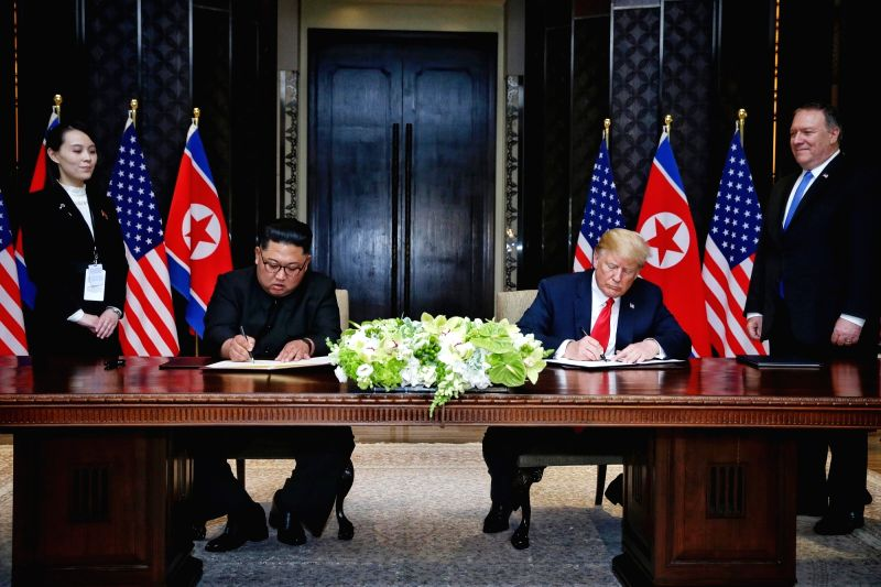 SINGAPORE, June 12, 2018 - Top leader of the Democratic People's Republic of Korea (DPRK) Kim Jong Un (2nd L) and U.S. President Donald Trump (2nd R) sign a joint statement in Singapore on June 12, ...