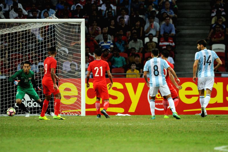 SINGAPORE, June 13, 2017 - Argentina's player Federico Fazio (1st R) scores during the international friendly match between Singapore and Argentina held in the National Stadium of Singapore on Jun ...