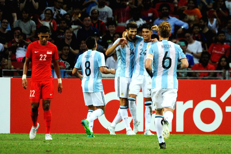 SINGAPORE, June 13, 2017 - Argentina's player Federico Fazio (3rd R) celebrates scoring during the international friendly match between Singapore and Argentina held in the National Stadium of ...