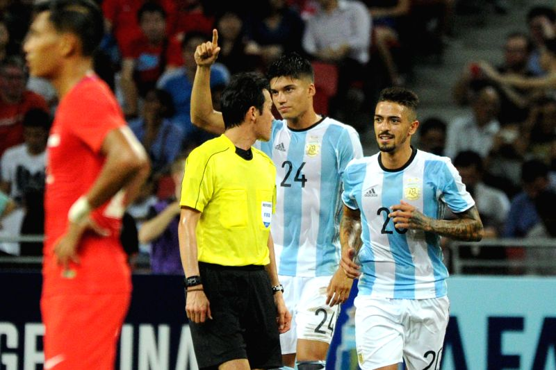 SINGAPORE, June 13, 2017 - Argentina's player Carlos Correa (2nd R) celebrates scoring during the international friendly match between Singapore and Argentina held in the National Stadium of ...