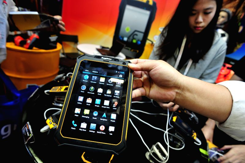The waterproof RugGear tablet RG900 is displayed on the second day of the CommunicAsia exhibition in Singapore's Marina Bay Sands Expo June 18, 2014. (Xinhua/Then