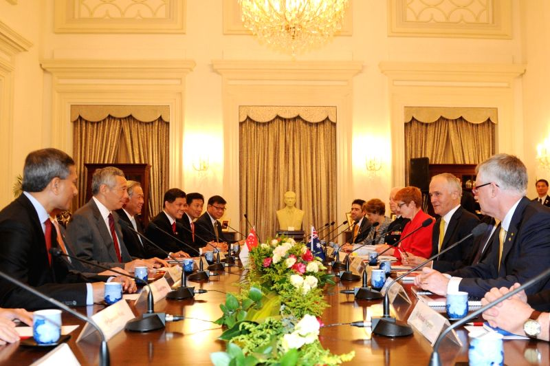 SINGAPORE, June 2, 2017 - Singapore's Prime Minister Lee Hsien Loong (2nd L) holds talks with Australia's Prime Minister Malcolm Turnbull (2nd R) in Singapore June 2, 2017. Turnbull began a three-day ... - Lee Hsien Loong